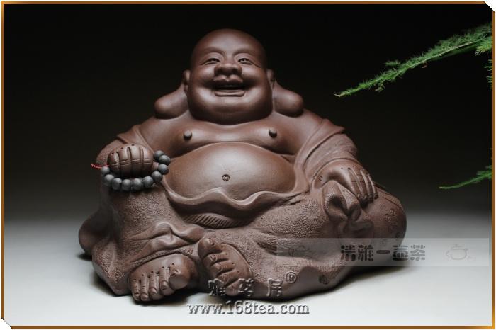 大肚能容万物,微笑看破群生。