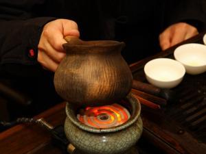 哈尼族煎茶图片